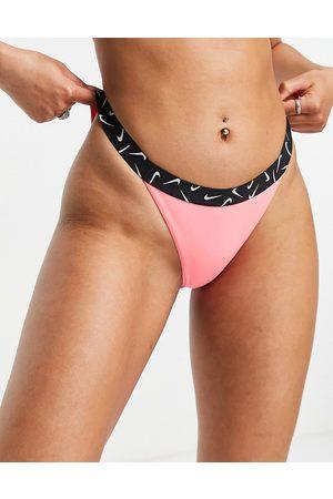 Nike Swoosh taped bikini bottoms in pink