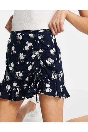 Hollister Mini swing ruched skirt with floral print in navy