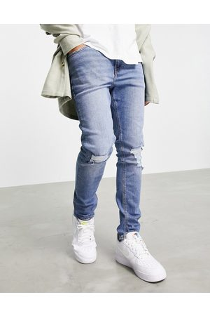 ASOS Skinny jeans in mid wash blue with knee rips