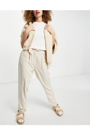 Object Tapered trousers with self belt in stone