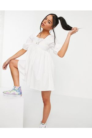 VIOLET ROMANCE Mini dress with coloured stitching in white