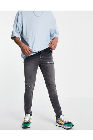 ASOS Skinny jeans in washed black with abrasions