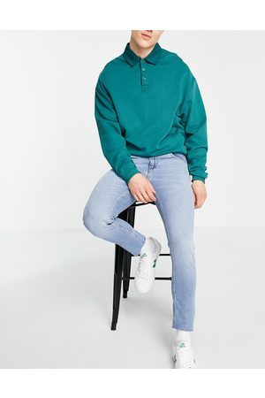 ASOS Stretch slim jeans with 'less thirsty' wash in light blue with raw hem