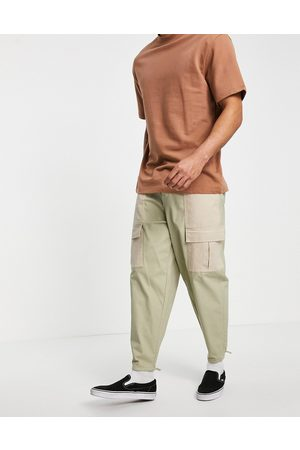 ASOS Oversized tapered trousers with contrast laid on panels