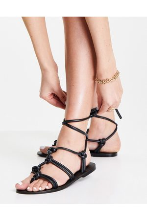 ASRA Shobha knotted flat sandals with ankle ties in black leather
