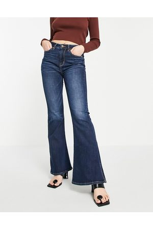 AMERICAN EAGLE Super high rise flared jeans with distressing in dark blue