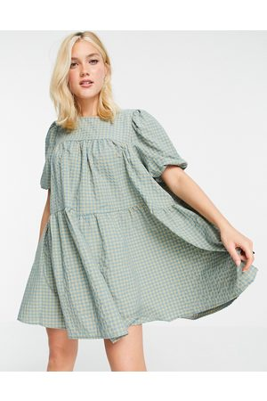 In The Style X Olivia Bowen puff sleeve tiered smock dress in green check print