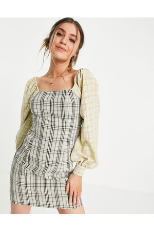 Lola May Off shoulder mini dress in mixed check print