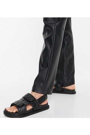 Truffle Collection Wide fit quilted double strap flat sandals in black