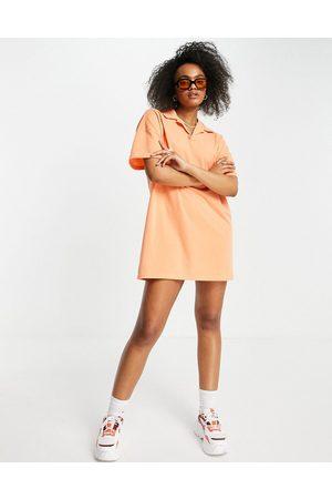 Lola May Short sleeve polo shirt dress in coral