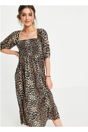 Lola May Shirred front tie neck smock dress in leopard print