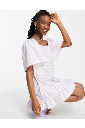 Wednesday's Girl Relaxed mini smock dress in daisy printed gingham