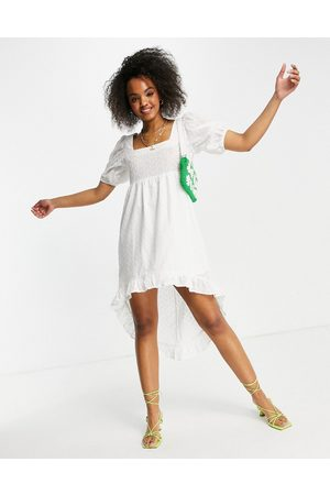 Lola May Broderie anglais dip hem mini dress in white