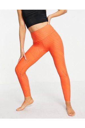 Onzie Selenite midi leggings in orange