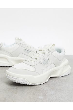 Lacoste Ace Lift chunky overlay trainers in off white mix
