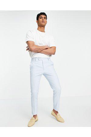 ASOS Hombre Slim y skinny - Wedding skinny suit trousers in blue geo jacquard