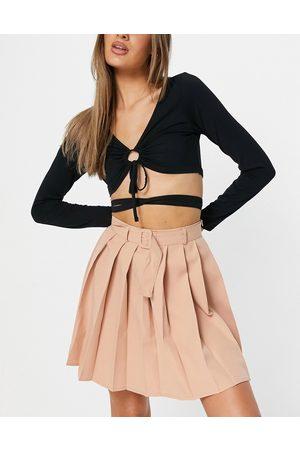 Parisian Pleated tennis skirt with belt in beige