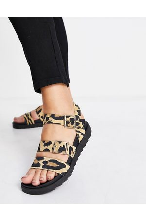 Schuh Chaser leather buckle strappy sandals in animal