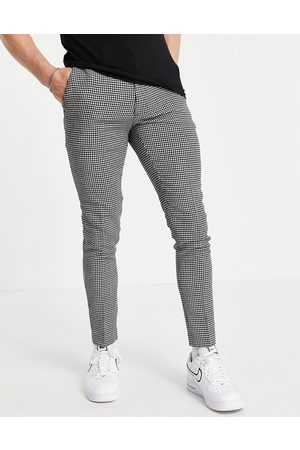 ASOS Super skinny wool mix smart trouser in black puppy tooth