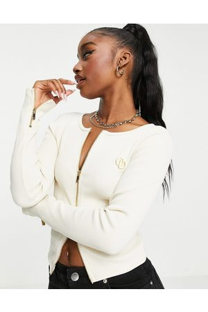 The O Dolls Collection ODolls Collection zip detail ribbed logo top co ord in cream