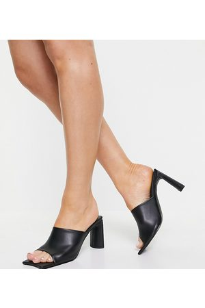 Public Desire Vice heeled mules with statement toe in black