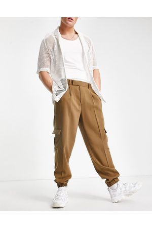 ASOS Oversized tapered cargo smart trousers in tan crepe
