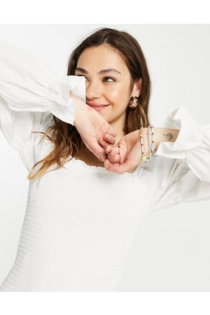ONLY Organic cotton shirred blouse with ruched long sleeves in white
