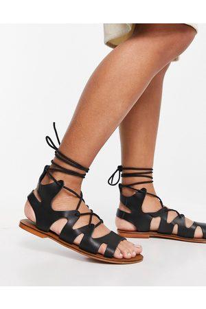 ASRA Savannah flat sandals with ankle tie in black