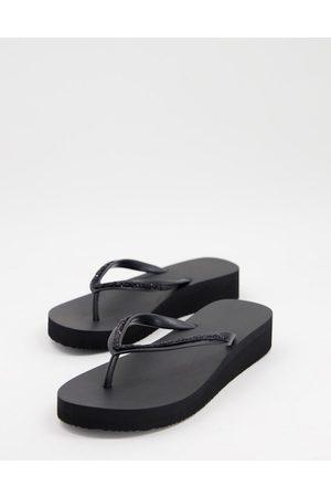 Accessorize Eva wedge thong flip flops in black
