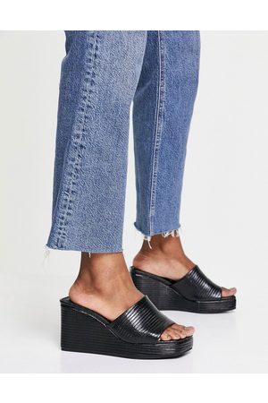ASOS Topaz square toe wedge mules in black