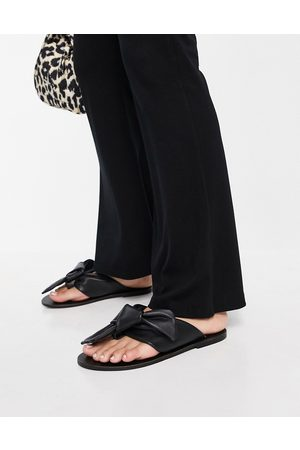 ASRA Susanna flat sandals in with knot detail in black