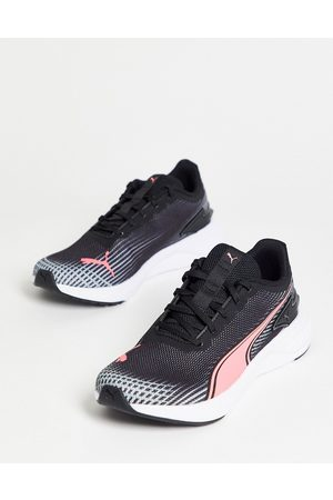 PUMA Running accelerate trainers in black and pink