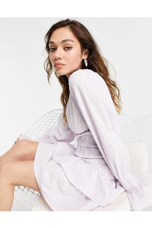 VIOLET ROMANCE Tiered mini dress in lilac gingham