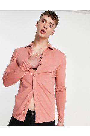 ASOS Hombre Manga larga - Organic long sleeve button through jersey shirt in washed pink