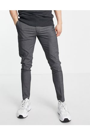 ASOS Hombre Chinos - Super skinny smart trousers in charcoal pin dot