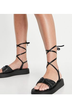 Simmi Wide Fit Simmi London Wide Fit Naeva ankle tie flatform sandals in black