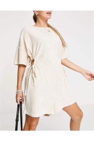 ASOS Towelling playsuit with cut out in cream