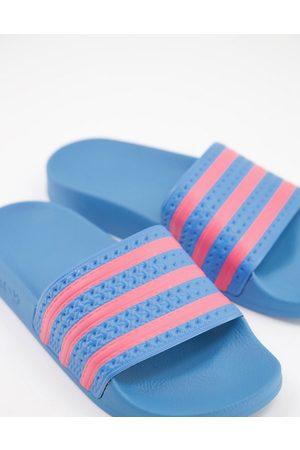 adidas Adilette sliders in blue