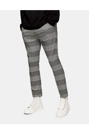 Topman Stretch skinny joggers in brown and stone check