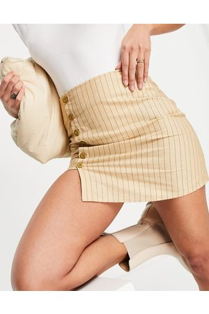 Motel Mini a line skirt in stripe with button detail