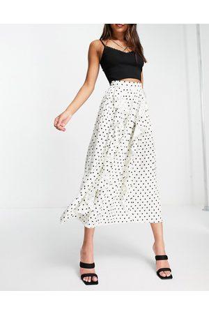 Little Mistress Pleated midi skirt with ruffle details in cream polka dot