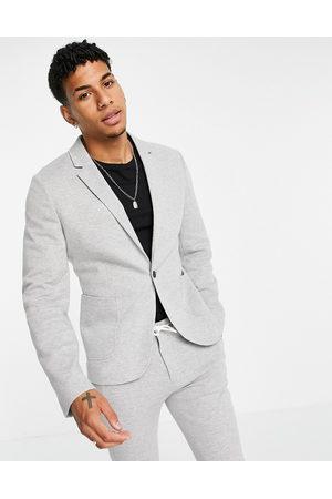 ASOS Hombre Sacos - Super skinny suit jacket in grey jersey