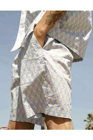 adidas Summer Club' all over logo print drawstring shorts in lilac