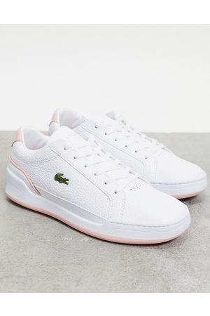 Lacoste Challenge cupsole trainers in white with pink trim