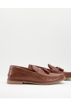 ASOS Tassel loafers in tan leather with natural sole