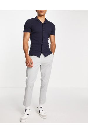 ASOS Hombre Chinos - Cigarette chinos with pleats in light grey