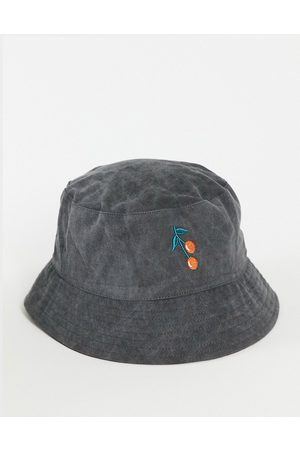 ASOS DESIGN Washed bucket hat with cherry embroidery in black