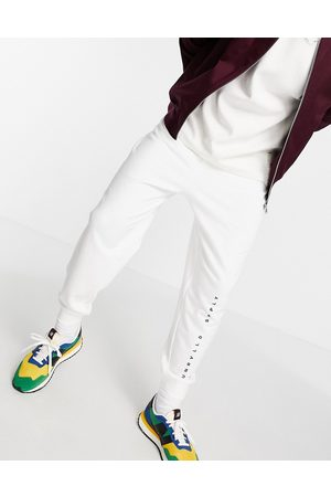 ASOS ASOS Unrvlld Spply relaxed joggers with logo print in white