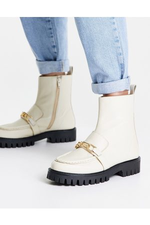 ASRA Bobbie chunky flat boots with gold chain in milk leather