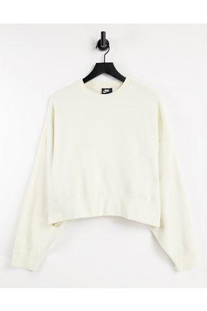 Nike Mini swoosh oversized boxy sweatshirt in off white
